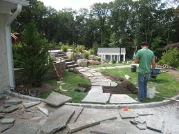 Laying Patio Slabs On Grass How To Install A Flagstone Path In A Lawn Landscapeadvisor