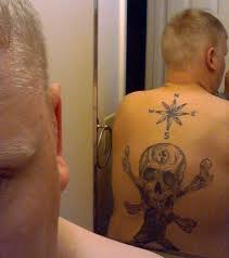 navy atheist forced to permanently cover up a bad religion tattoo