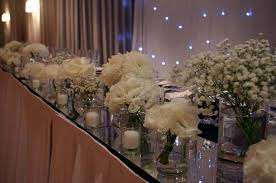Bridal table decoration assorted glassware candles white flowers