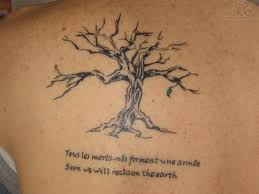 tree and wording tattoos on back for in 2017 photo