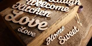 wooden words signs in a joined up script style