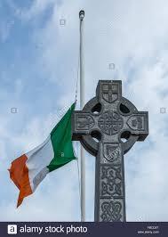 Celtic Cross Half - an tricolour flies at half mast on a pole a