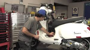 how to replace the battery on a modern vespa youtube