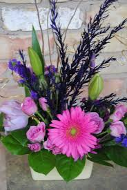 purple flowers pink gerber daisy small spring floral arrangement