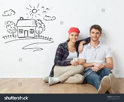 young couple sitting on floor room stock photo 596550983