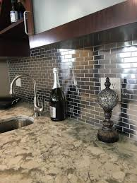 kitchen backsplash stainless steel panel behind range metallic