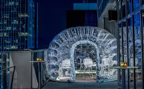 drink inside a bubble at the highest rooftop hotel bar in nyc