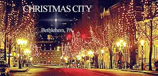 Christmas Lights In Bethlehem And Star Visible In Distance