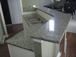 granite countertop black wood cabinets 60 40 sink delta single