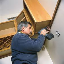 how to trim the bottom of a cabinet how to hang kitchen cabinets this house
