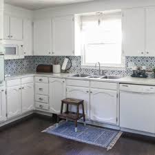 painting my kitchen cabinets blue painting oak cabinets white an amazing transformation