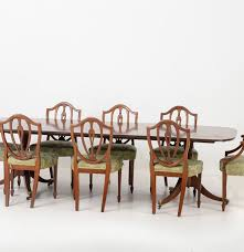 circa 1950 mahogany dining table and eight shield back chairs ebth
