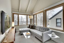microfiber sectional in sunroom rustic with wall mounted flat