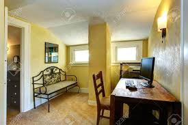 Small Study Room Interior Design Small Study Room With Yellow Wall And Column White Vaulted