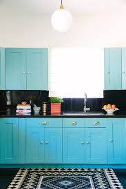 Turquoise Kitchen Cabinets With Black Backsplash And Counters And - Turquoise kitchen cabinets