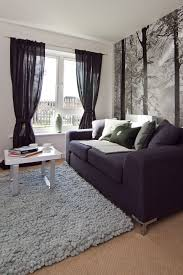 living room with black sheer curtains and half wallpaper good