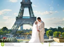 Beautiful Eiffel Tower by Bride And Groom In Paris Near The Eiffel Tower Stock Photo