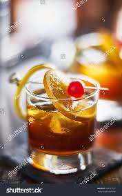 old fashioned cocktail old fashioned cocktail garnished cherry orange stock photo