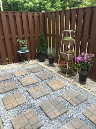 part 2 of our patio makeover how to lay a concrete paver rock