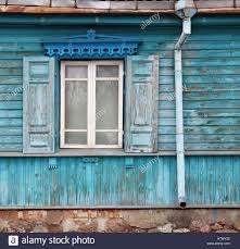 windows with an open sun blinds in the old destroyed blue wooden