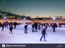 ice skaters on the outdoor ice rink at christmas parkers piece