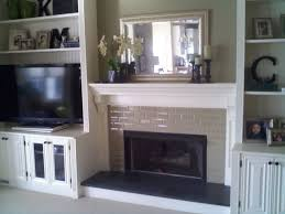 fireplace with built in bookshelves custom trimwork and regarding