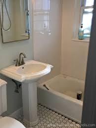bathroom kohler pedestal sink with graff faucets and mirrored