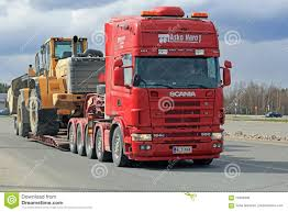 volvo heavy vehicles scania 164g transports heavy volvo wheel loader editorial image