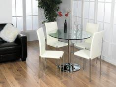 impressive round glass and wood dining table and chairs home and