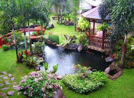 asian backyard garden design with an oriental style bridge over a