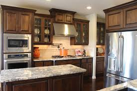 Knotty Hickory Kitchen Cabinets Burrows Cabinets Kitchen In Stained Knotty Alder And Mullion Doors