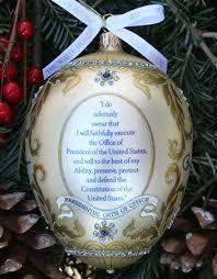 a handcrafted white house ornament depicting president