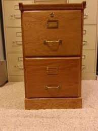 solid oak file cabinet 2 drawer we are selling a gorgeous solid wood file cabinet it is a lateral
