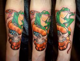 forearm skull tattoos forearm colour snake frog and skull tattoo chronic ink
