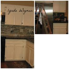 lynda bergman decorative artisan linda s new kitchen cabinets she has such pretty kitchen accessories pitchers copper pots dishes etc but when i m finished with a job i don t always get to see everything put