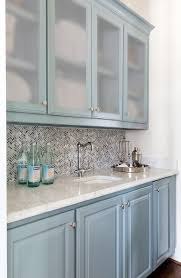 frosted glass backsplash in kitchen blue bar cabinets with frosted glass doors transitional kitchen
