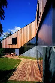 l shaped hillside family house