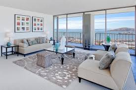 rug on top of carpet area rug over carpet living room contemporary with white sofas on