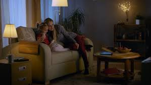 Design A Sofa Long Shot Of A Father Mother And Little Watching Tv They
