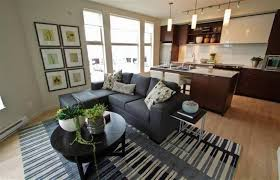 condo living room design with round coffee table and framed wall