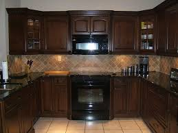 dark countertops with dark cabinets brown kitchen cabinets with dark countertop and lighter colored tile