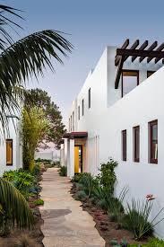 small modern house home decor waplag interior design elegant beach santa barbara coastal beach guest house nma architects hgtv narrow walkway leading to retreat home