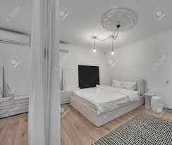 white walls in bedroom contemporary bedroom with white walls and a parquet with a carpet