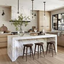 kitchen island decor douglass fir cabinetry fabricated by local artisans echoes the