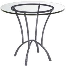 attractive flat polished round glass dining table with black metal