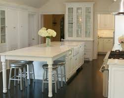 Kitchen Island Table Legs White Kitchen Island With Wood Countertop And Gray Stools In Legs