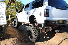 Ford Bronco Lifted Mud Truck - big excursion flexed out offroad http www mkmcustoms com