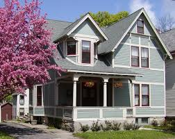 impressing light blue house exterior paint idea with brown window