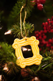 yellow peephole frame ornament 2 25 x 2 25 inspired by