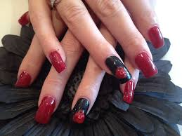 acrylic nails with red and black polish and 3d flower nail